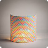 Fabric half lamp shade for wall light in Petit Pan fabric Wasabi